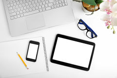 workspace-laptop-blank-digital-tablet-smartphone-white-table-58849571